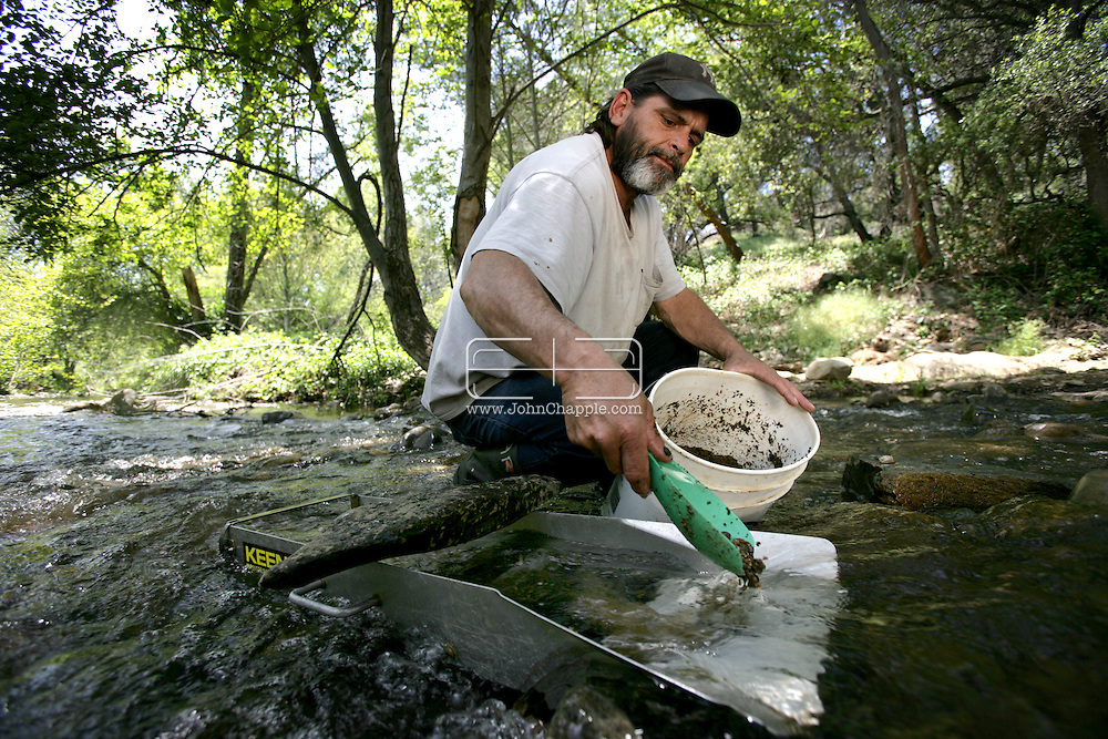30th April 2009. Jamestown, California. The recession, unemployment and record prices are fuelling a new Gold Rush - 160 years after thousands descended on California, seeking riches. Pictured is Rudy G. Beauford (42), an out of work carpenter using a sluice, which is designed to catch gold. PHOTO © JOHN CHAPPLE / www.chapple.biz.tel:  (001) 310 570 9100