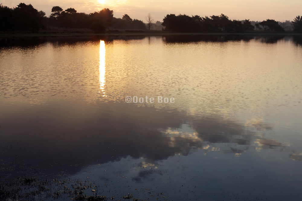 a beautiful sunrise landscape with water and cloud reflection Holland
