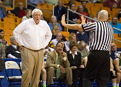 Greenbrier East head coach Jim Justice argues with a referee against South Charleston during a first round game at the Charleston Civic Center.