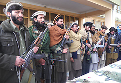 Taliban militants attend a surrender ceremony in Kunar province, eastern Afghanistan, Feb. 11, 2013. Up to 18 Taliban militants renounced violence and surrendered in eastern Afghan province of Kunar on Monday, authorities said., Monday February 11, 2013. Photo by Imago / i-Images. UK ONLY..