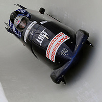 28 February 2007:     The Great Britain 1 bobsled driven by Lee Johnston with sidepushers Karl Johnston and Dan Money, and brakeman  Allyn Condon drive through turn 20 in the 1st run at the 4-Man World Championships competition on February 27 at the Olympic Sports Complex in Lake Placid, NY.