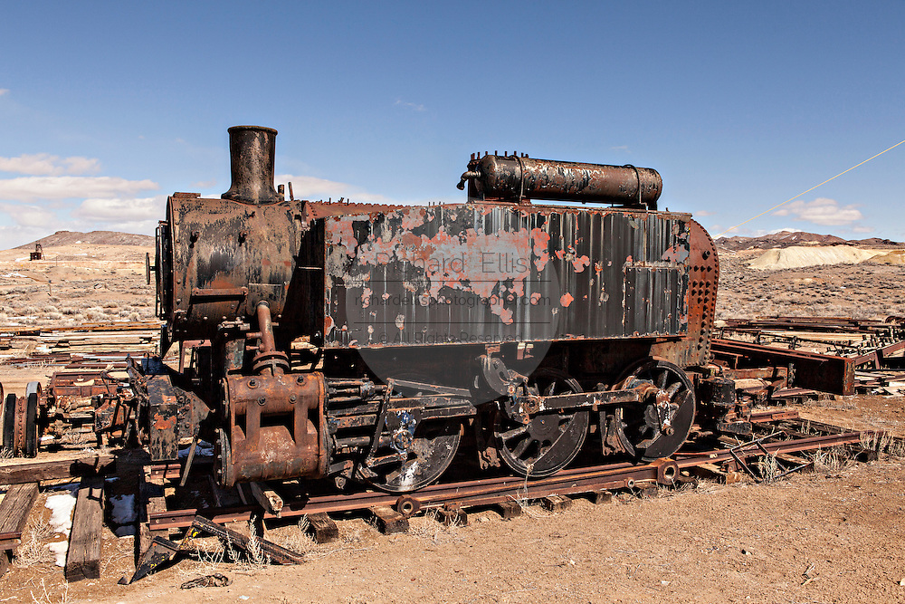 Old railroad steam engine in former gold mining boomtown turned ghost town Goldfield, Nevada, USA