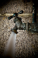 Old spigot in Oakland alley flowing water.  Copyright 2008 Reid McNally.