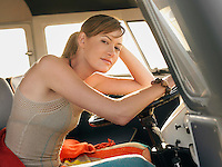 Woman in sitting in front seat of van
