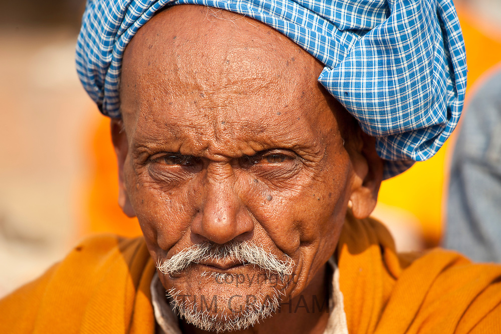 Hindu pilgrim with turban at Dashashwamedh Ghat in holy city of Varanasi, Benares, India