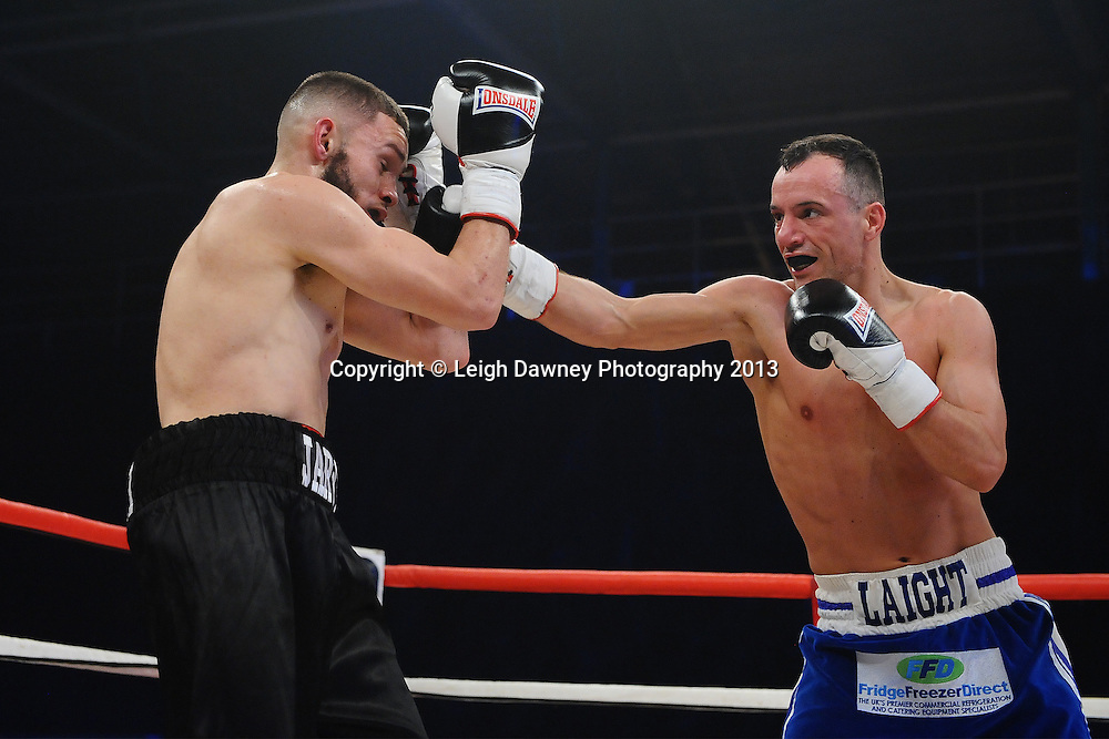 Thomas Jarvis (black shorts) defeats Kristian Laight in a Light Welterweight contest on 15th March 2014 at the Rivermead Leisure Centre, Reading, Berkshire. Promoted by Hennessy Sports. © Leigh Dawney Photography 2014.