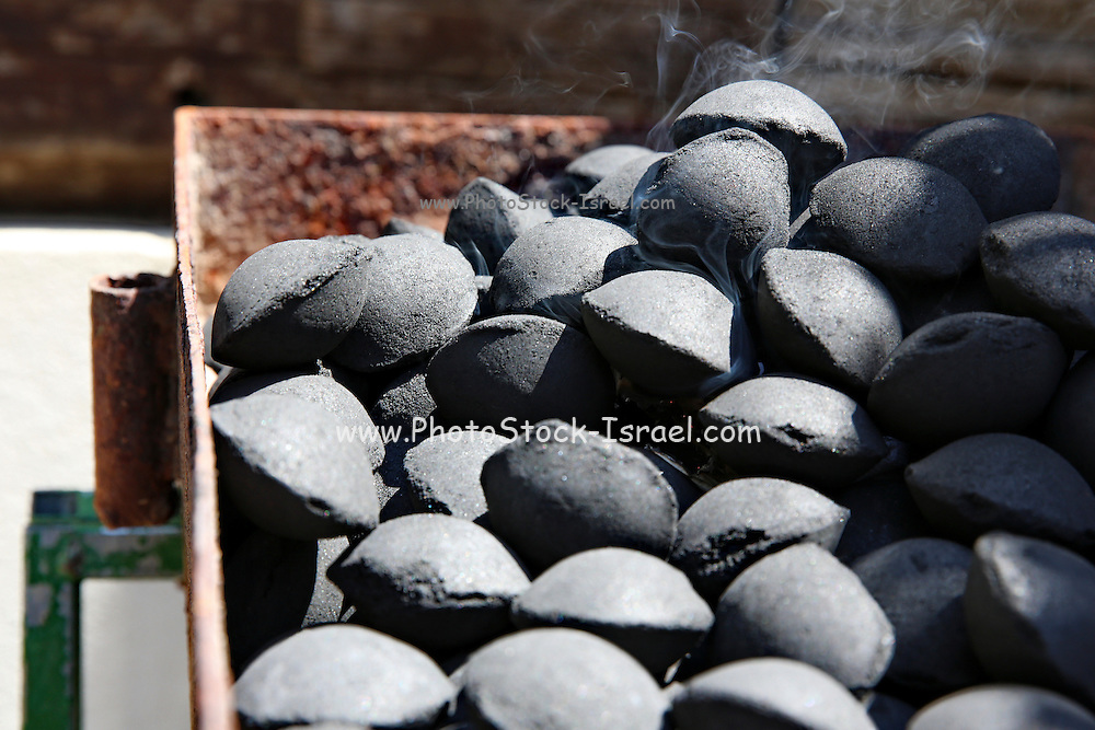 A barbecue with charcoal stones