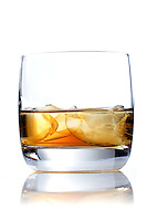 Glass of whisky on white background
