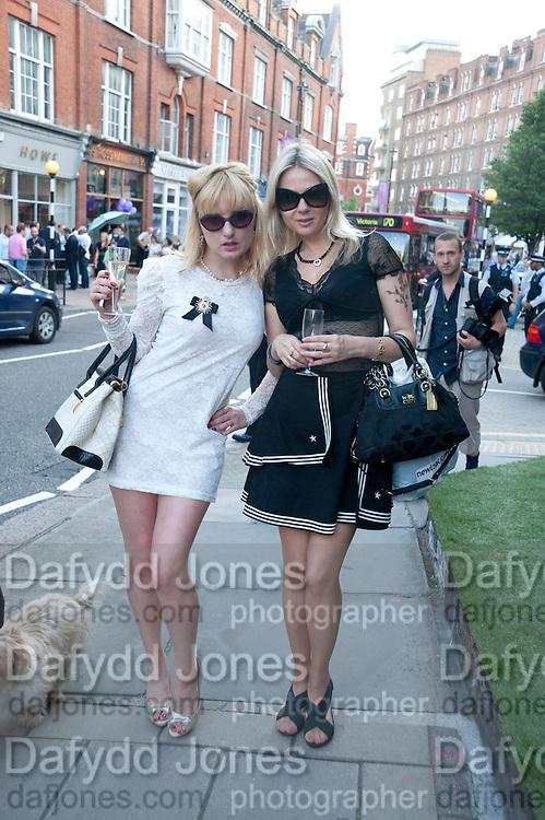 ELENA STRYGINA; ( WHITE DRESS)  ANASTASIA FOSTER, Pimlico Road party. 22 June 2010. -DO NOT ARCHIVE-© Copyright Photograph by Dafydd Jones. 248 Clapham Rd. London SW9 0PZ. Tel 0207 820 0771. www.dafjones.com.
