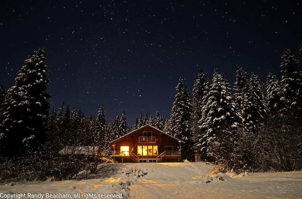House and stars at night in winter. Yaak Valley, Montana.