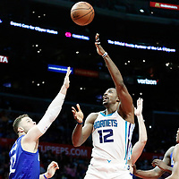 31 December 2017: Charlotte Hornets center Dwight Howard (12) goes for the baby hook past LA Clippers guard Milos Teodosic (4) and LA Clippers forward Blake Griffin (32) during the LA Clippers 106-98 victory over the Charlotte Hornets, at the Staples Center, Los Angeles, California, USA.