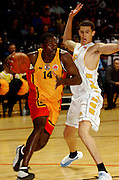 Willie Burton moves the ball up court during the NBL basketball match between the Wellington Saints and the Mighty Hawks, 14 April, 2002 at the Wellington Event Centre. Photo: PHOTOSPORT<br /><br /><br /><br />046437 *** Local Caption ***