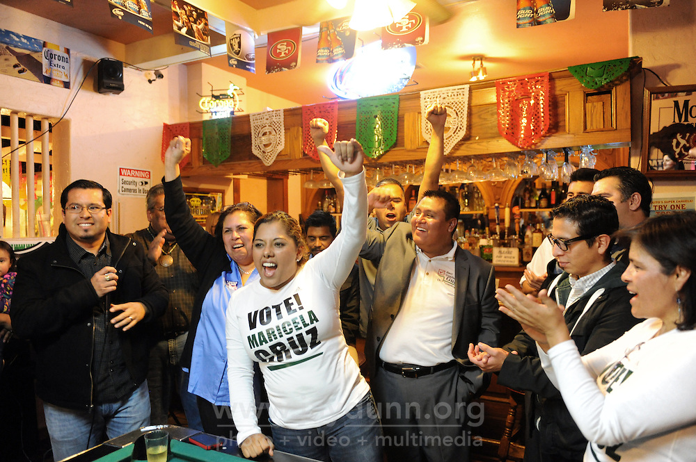 Candidates Maricela Cruz, in front, Noemi Armenta, in blue, and Guadalupe Guzman, with gray jacket, celebrate their election results at Taquitos Restaurant on Tuesday night, November 5th in Salinas.