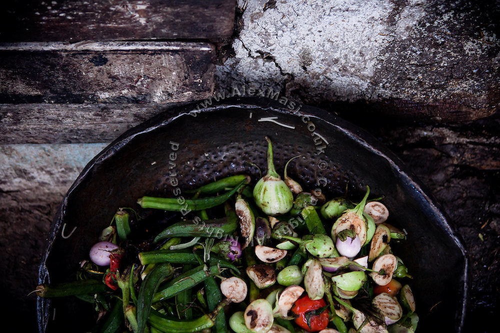Vegetables are laying inside a home in the impoverished Oriya Basti colony in Bhopal, Madhya Pradesh, located near the former Union Carbide (now DOW Chemical) industrial complex, site of the infamous 1984 gas disaster.