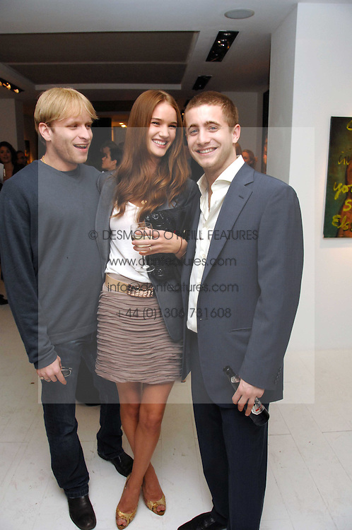 Left to right, JAMIE WOOD, ROSIE HUNTINGTON-WHITELEY and TYRONE WOOD at an exhibition of paintings by artist Rene Richard at the Scream Gallery, Bruton Street, London on 3rd April 2008.<br />