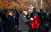 American Legion Commander Herman Chamberlain addresses the crowd at Veteran's Square Sunday morning during the Veteran's Day service.  (Karen Bobotas/for the Laconia Daily Sun)