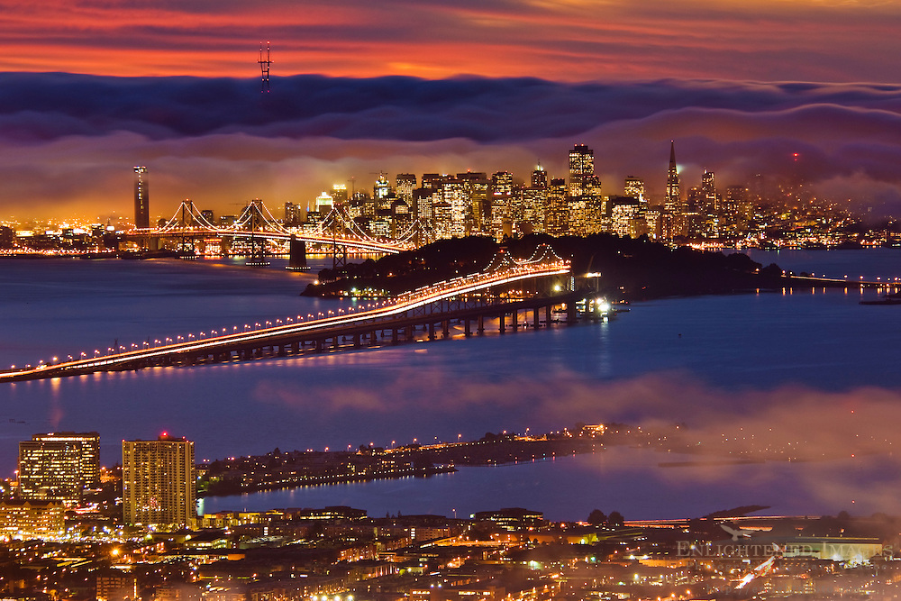 San Francisco city lights and fog over San Francisco Bay at sunset, California