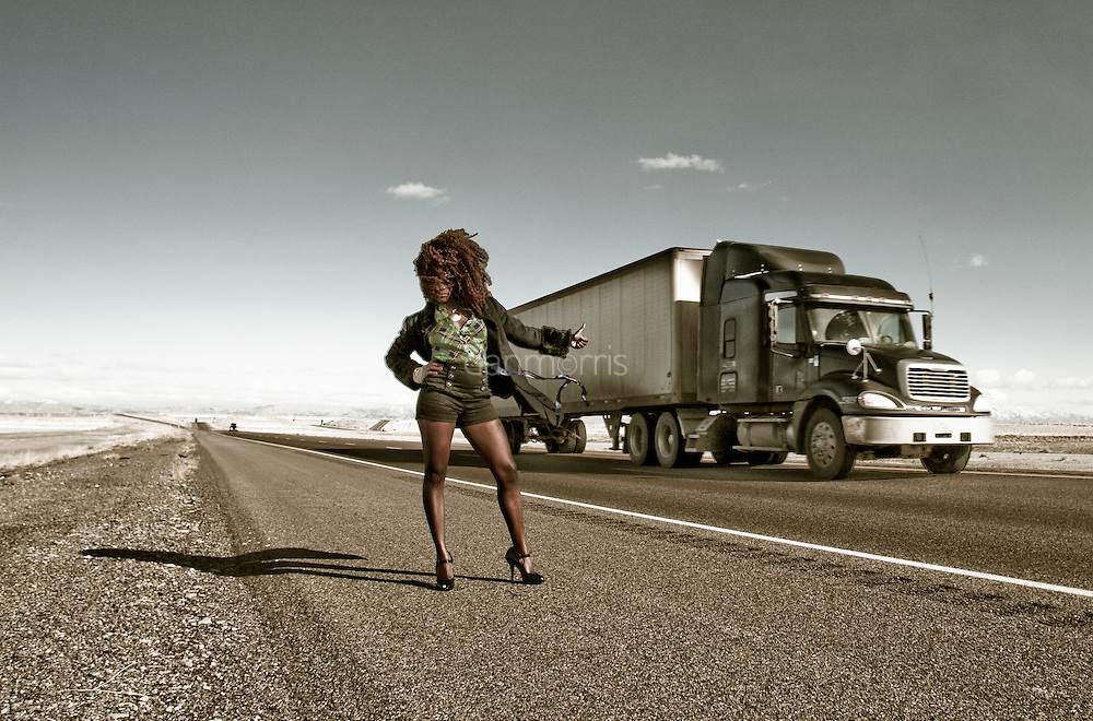 African American woman hitchhiking on I-15, Bonneville Salt Flats, Wendover, Nevada