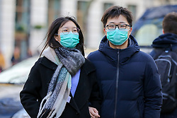 © Licensed to London News Pictures. 01/02/2020. London, UK. An Asian couple are seen in London's Chinatown wearing face masks following the outbreak of Coronavirus in Wuhan, China. <br /> According to the Department of Health, 203 people have been tested in the UK, with 201 results coming back negative and two positive. One of the two people to test positive for is a student at the University of York. Photo credit: Dinendra Haria/LNP
