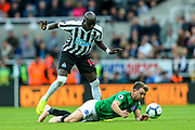 Dale Stephens (#6) of Brighton & Hove Albion grabs the ball as he is fouled by Mohamed Diame (#10) of Newcastle United during the Premier League match between Newcastle United and Brighton and Hove Albion at St. James's Park, Newcastle, England on 20 October 2018.