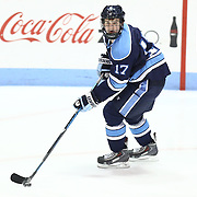 Andrew Tegeler #17 of the Maine Black Bears with the puck during the game at Matthews Arena on February 22, 2014 in Boston, Massachusetts. (Photo by Elan Kawesch)