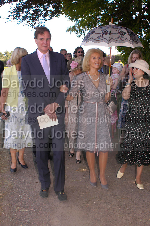 Jonathan and Elizabeth Aitken. Marriage of Emilia Fox to Jared Harris. St. Michael's and All Angels. Steeple. Nr. Wareham. Dorset. 16 July 2005. ONE TIME USE ONLY - DO NOT ARCHIVE  © Copyright Photograph by Dafydd Jones 66 Stockwell Park Rd. London SW9 0DA Tel 020 7733 0108 www.dafjones.com