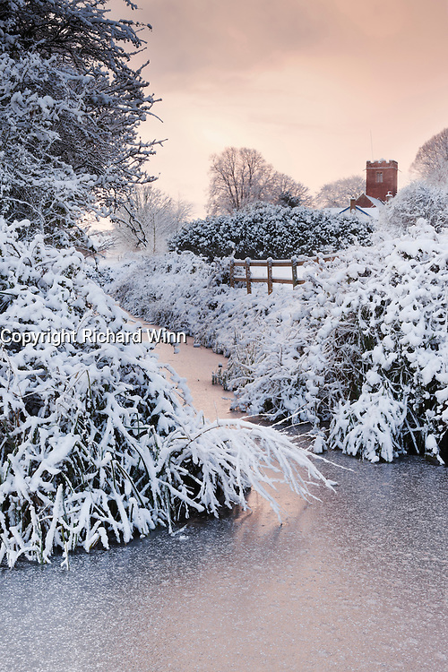 View of Wembdon Rhyne at dawn, after overnight heavy snow, including St George's Church.
