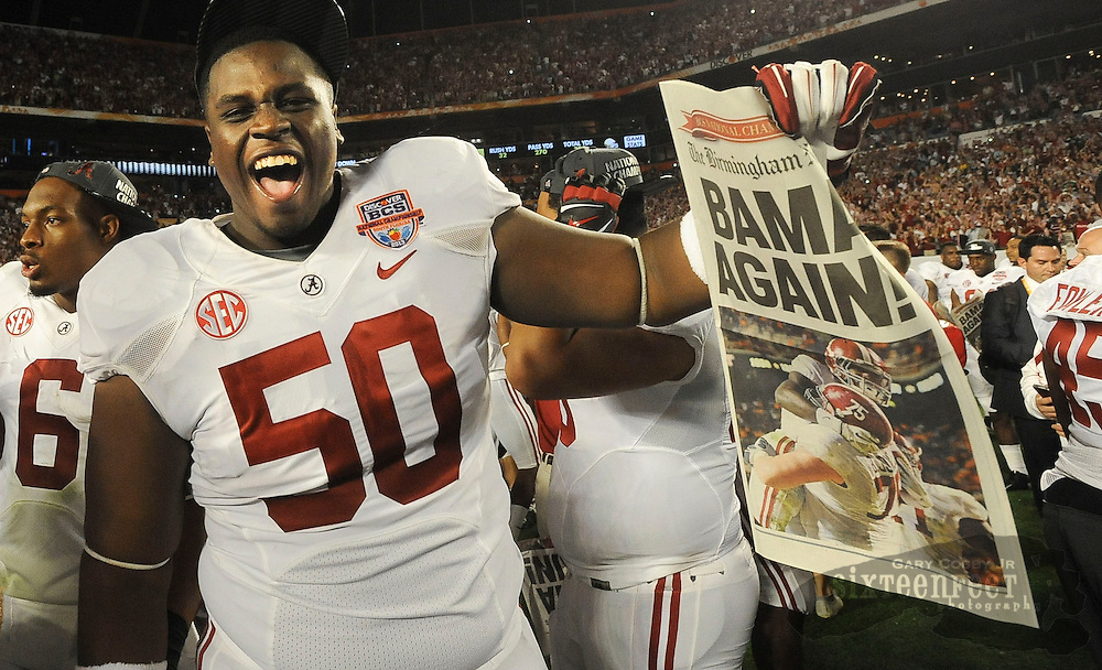 Daily Photo by Gary Cosby Jr.   Alabama celebrates its 15th National Championship after dominating Notre Dame in the BCS Championship Game Monday, January 7, 2013.  Alabama lineman Alphonse Taylor (50) holds up a paper proclaiming Bama Again!