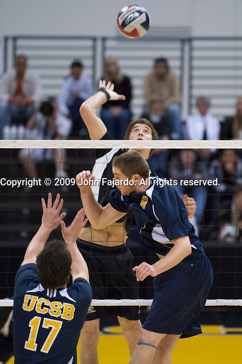 Jim Baughman(rear) takes advantage of the over pass as Vince Devany(8) and Sam Molsenco(17) are late to the block in the Mountain Pacific Sports Federation match against Santa Barbara at the Walter Pyramid, Long Beach CA, Friday, April 10, 2009.  Long Beach State wins the match in four sets 30-20, 26-30, 30-20, 30-24.
