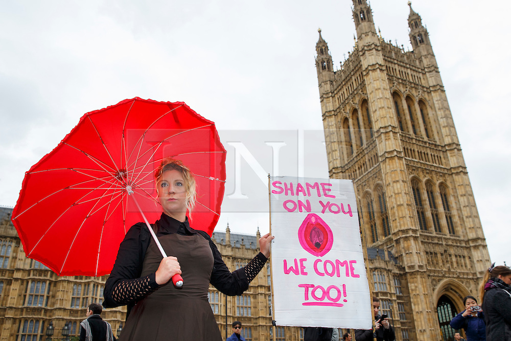 © Licensed to London News Pictures. 12/12/2014. LONDON, UK. Demonstrators protesting against the proposed restrictions on British producers of online porn, which bans actions such as spanking, facesitting, physical restraint and female ejaculation being filmed, outside Houses of Parliament in London on Friday, 12 December 2014. Photo credit : Tolga Akmen/LNP