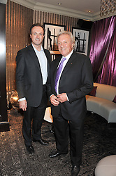 Left to right, SIMON THOMAS Chairman of the Hippodrome and JIMMY THOMAS President of the Hippodrome at a party to celebrate the launch of the Hippodrome Casino, Leicester Square, London on 12th July 2012.