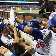 NEW YORK, NEW YORK - May 28:  Chase Utley #26 of the Los Angeles Dodgers is congratulated by team mates as he returns to the dugout after hitting a grand slam home run in the top of the seventh inning during the Los Angeles Dodgers Vs New York Mets regular season MLB game at Citi Field on May 28, 2016 in New York City. (Photo by Tim Clayton/Corbis via Getty Images)