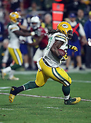 Green Bay Packers running back Eddie Lacy (27) runs for a third quarter gain of 14 yards during the NFL NFC Divisional round playoff football game against the Arizona Cardinals on Saturday, Jan. 16, 2016 in Glendale, Ariz. The Cardinals won the game in overtime 26-20. (©Paul Anthony Spinelli)