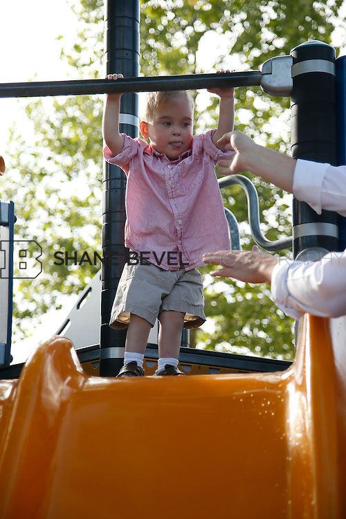 5/28/15 6:06:20 PM -- Miracle Miles and his family pose for portraits and play at the QuikTrip park for the 2015 Saint Francis Health System advertising campaign. <br /> <br /> Photo by Shane Bevel