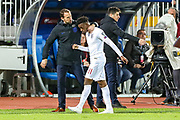 England Head Coach Gareth Southgate shares some words with England midfielder Callum Hudson-Odoi  after substitution during the UEFA European 2020 Qualifier match between Kosovo and England at the Fadil Vokrri Stadium, Pristina, Kosovo on 17 November 2019.