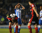 Inigo Calderon, Brighton defender sees a chance go begging during the Sky Bet Championship match between Brighton and Hove Albion and Huddersfield Town at the American Express Community Stadium, Brighton and Hove, England on 14 April 2015.
