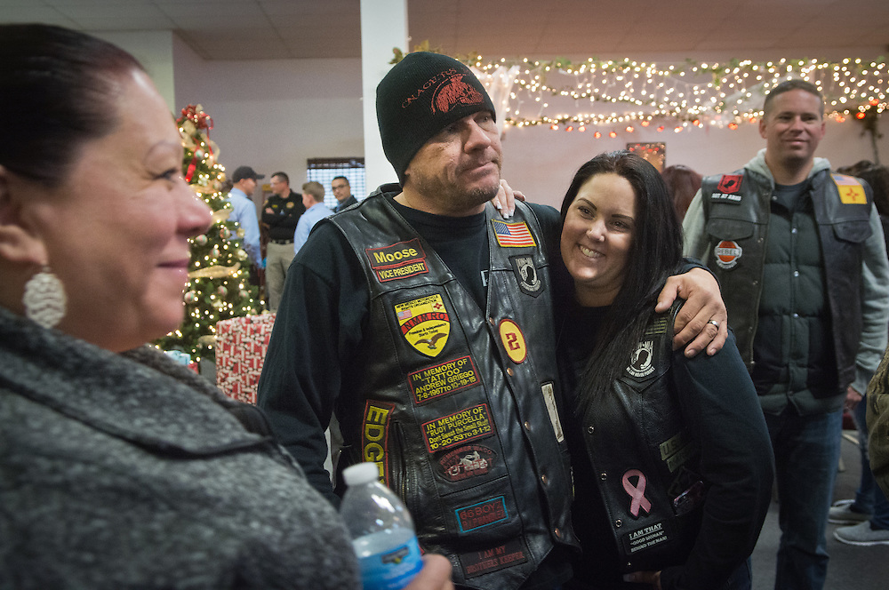 mkb122216/metro/Marla Brose122116<br /> Marty Gagne, second from left, and his wife Amy Gagne, chat with Patricia Savage, of the Albuquerque Police Dept. Operation Hope &quot;Making a Difference&quot;, before a toy distribution. Gagne is one of the recipients of the Angels Among Us award. Gagne, a member of the motorcycle club Onagers, organizes Duke City Toy Run and other charitable efforts. (Marla Brose/Albuquerque Journal)