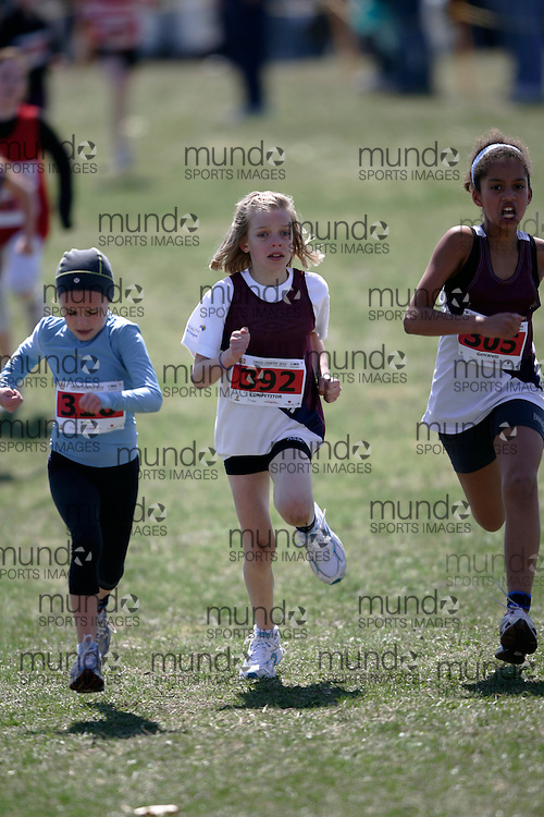 (Kingston, Canada---11 April 2010) Annabella Adam (#310) of Holy Name CS, competitor #392 and Celitha Gencarelli (#305) of Lancaster Drive PS runs in the Elementary Girls race at the 17th World University Cross Country Championships (FISU) held on the Fort Henry Hill course in Kingston, Ontario, Canada. .Geoff Robins/ Mundo Sport Images..This photograph is Copyright Geoff Robins / Mundo Sport Images, 2010. For information, go to www.mundosportimages.com or contact info@mundosportimages.com.