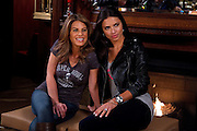 Jillian Michaels and Adriana Lima film a segment for the TV show Super Bowl's Greatest Commercials in Indianapolis, Indiana.