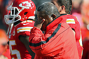 Kansas City Chiefs head coach Romeo Crennel wipes his eyes after being consoled by members of the Carolina Panthers before the start of an NFL football game at Arrowhead Stadium in Kansas City, Mo., Sunday, Dec. 2, 2012. Crennel and his team decided to go ahead and play their game following the Saturday suicide of Chiefs linebacker Jovan Belcher who murdered his girlfriend before taking his life. (AP Photo/Colin E. Braley)