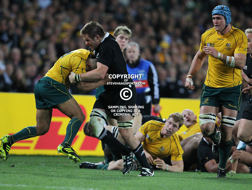 AUCKLAND, NEW ZEALAND - OCTOBER 16, Richie McCaw cap tackles Will Genia during the 2011 IRB Rugby World Cup Semi Final match between New Zealand and Australia at Eden Park on October 16, 2011 in Auckland, New Zealand<br /> Photo by Steve Haag / Gallo Images