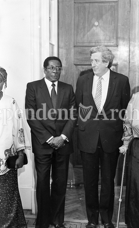 Robert Mugabe with Taoiseach Garret Fitzgerald in Dublin during Mugabe's two-day visit to Ireland. 8/09/1983. (Part of the Independent Newspapers Ireland/NLI Collection).