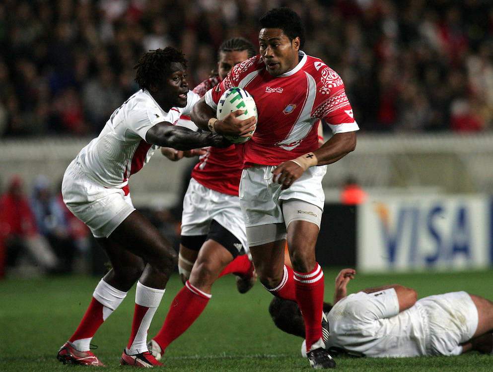 Sukanaivalu Hufanga goes past Paul Sackey to score the first try for Tonga. England v Tonga, Parc Des Princes, Paris, France, 28th Septemeber 2007. Rugby World Cup 2007.
