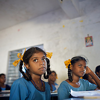 "Vijyashree (foreground) in class at the Government Girls High School, Venugopalapuram in Cuddalore.. .Vijita (age 14) and Vijyashree (age 11) Viswanathan lost their mother and brother to the tsunami in 2004. They continue to live in the fishing village of Thazanguda with their father Viswanathan, his second wife Kayalvizhi and their two children Sanjay (age 3) and Monica (age 1). ..Until the beginning of the 2009 academic year in June, Vijita and Vijyashree attended the local Thazanguda school. This village school teaches pupils only until the 8th Standard and with Vijita now entering the 9th, it was decided that the two daughters remain together and both travel 3km to the local town school: the Government Girls High School, Venugopalapuram in Cuddalore. ..At the same time Viswanathan decided he would cease day-to-day care of his daughters and place them in the Government Home for Tsunami Children, also in Cuddalore. This was not a move welcomed by either Vijita or Vijyashree and one afternoon after just two weeks at the orphanage, the two girls ran away. At roll call in the orphanage that evening the alarm was sounded and the two sisters were eventually located in Thazanguda waiting for their father and Kayalvizhi who were both away at the time. Realising his daughters' unhappiness, Viswanathan then took them out of the Government home. ..According to her class teacher, Vijita often compares her step-mother to her mother and concludes that she wants her mother back. Vijita confides in her teachers that her stepmother is forever demanding that she and her sister Vijyashree undertake housework. This frustration at home is tempered by the genuine love both sisters have for their father and two younger siblings Sanjay and Monica. Vijita expresses a lonelyness without her mother. Pushpavalli concludes that ""Vijita wants something else beyond the love of her father and sister"". ..Viswanathan appears genuinely to want the best for his two elder daughters. His experiment e"
