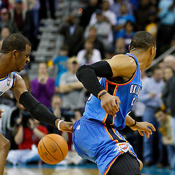 January 24,  2011; New Orleans, LA, USA; New Orleans Hornets point guard Chris Paul (3) steals the ball from Oklahoma City Thunder point guard Russell Westbrook (0) during the fourth quarter at the New Orleans Arena. The Hornets defeated the Thunder 91-89. Mandatory Credit: Derick E. Hingle