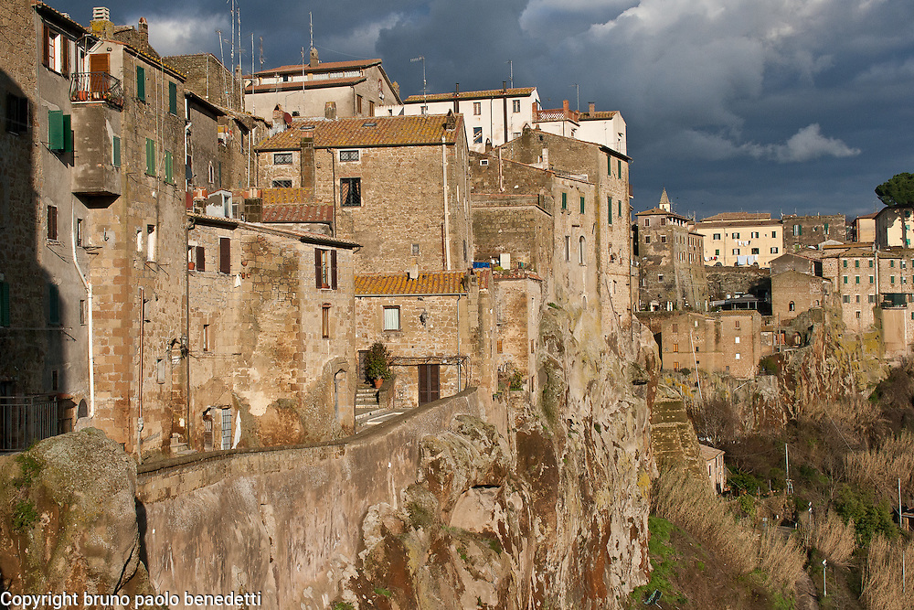 Traditional houses in Pitigliano, Italy, made in tuff stone. View in winter, Tuscany region.