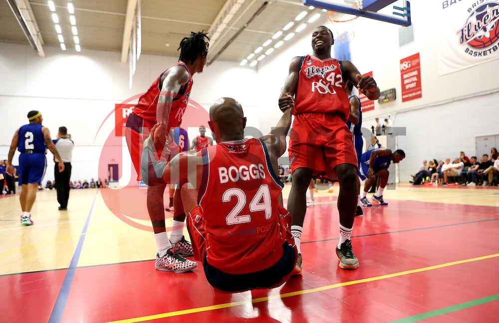 Brandon Boggs of Bristol Flyers is helped up by Daniel Edozie and Lovell Cook of Bristol Flyers - Mandatory by-line: Robbie Stephenson/JMP - 08/09/2016 - BASKETBALL - SGS Arena - Bristol, England - Bristol Flyers v USA Select - Preseason Friendly
