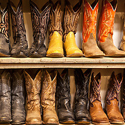 Gently-worn cowboy boots for sale at Horse Feathers boutique in Taos, New Mexico