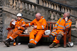Edinburgh, Scotland, UK. 24 July, 2020. As the construction industry starts to recover, these construction workers from new St James Centre development take a break for lunch on Princes Street in Edinburgh. Iain Masterton/Alamy Live News
