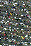 Car sit in rows on the Sunline auto salvage yard in an aerial photograph in Cedar Rapids on Wednesday, May 14, 2014.